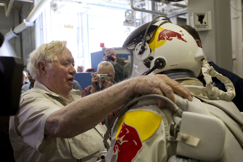 Photo -   In this Nov. 8, 2011, photo provided by Red Bull Stratos, retired U.S Air Force Col. Joe Kittinger, left, and pilot Felix Baumgartner of Austria greet each other during the Brooks chamber test for Red Bull Stratos, a mission to the edge of space to break the speed of sound in freefall, in San Antonio. On Tuesday, Oct. 9, 2012, if winds allow, in the desert surrounding Roswell, N.M., pilot Felix Baumgartner will attempt to break Kittinger's world record for the highest and fastest free fall. (AP Photo/Red Bull Stratos, Christian Pondella)