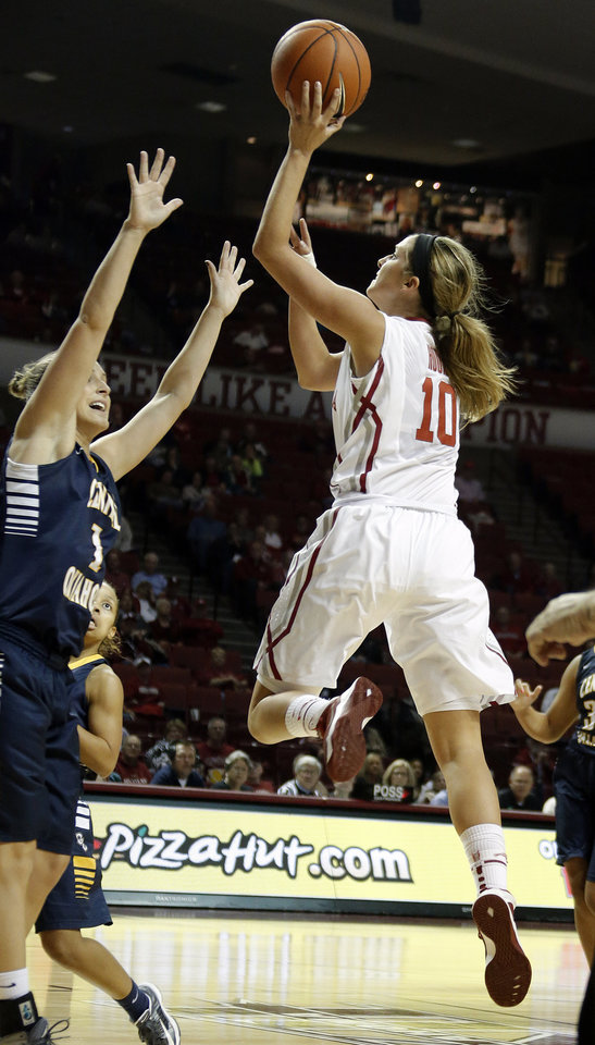 Photo - Oklahoma's Hook Morgan shoots over UCO's Jill Bryan during the college women's basketball game between the University of Oklahoma and University of Central Oklahoma at the Lloyd Noble Center in Norman, Okla., Tuesday, Nov. 5, 2013. Photo by Sarah Phipps, The Oklahoman