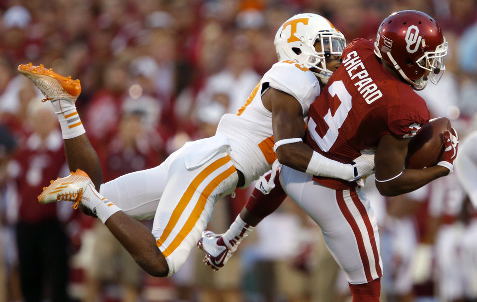 Photo - Oklahoma's Sterling Shepard (3) catches the ball in front of Tennessee's Cameron Sutton (23) during a college football game between the University of Oklahoma Sooners (OU) and the Tennessee Volunteers at Gaylord Family-Oklahoma Memorial Stadium in Norman, Okla., on Saturday, Sept. 13, 2014. Photo by Bryan Terry, The Oklahoman