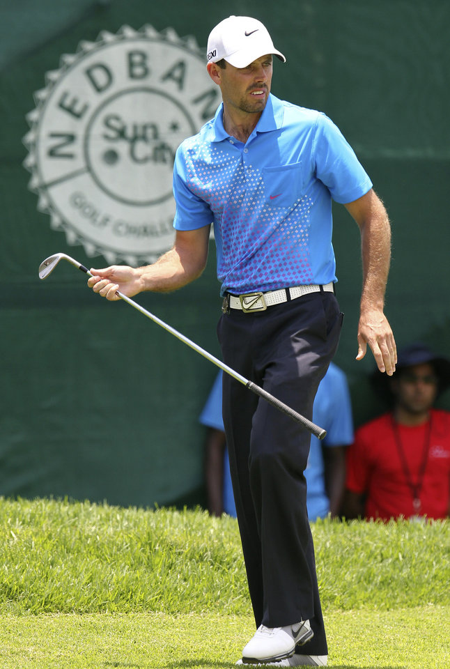 Photo - South African golfer Charl Schwartzel, reacts as his misses a birdie shot on the 1st hole, during the second day of the Nedbank Golf Challenge at the Gary Player Country Club in Sun City, South Africa on Friday Nov. 30, 2012. (AP Photo/Themba Hadebe)