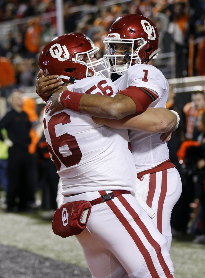 Photo - Oklahoma's Jalen Hurts (1) and Creed Humphrey (56) celebrate a touchdown catch by Hurts in the second quarter during the Bedlam college football game between the Oklahoma State Cowboys (OSU) and Oklahoma Sooners (OU) at Boone Pickens Stadium in Stillwater, Okla., Saturday, Nov. 30, 2019. [Nate Billings/The Oklahoman]