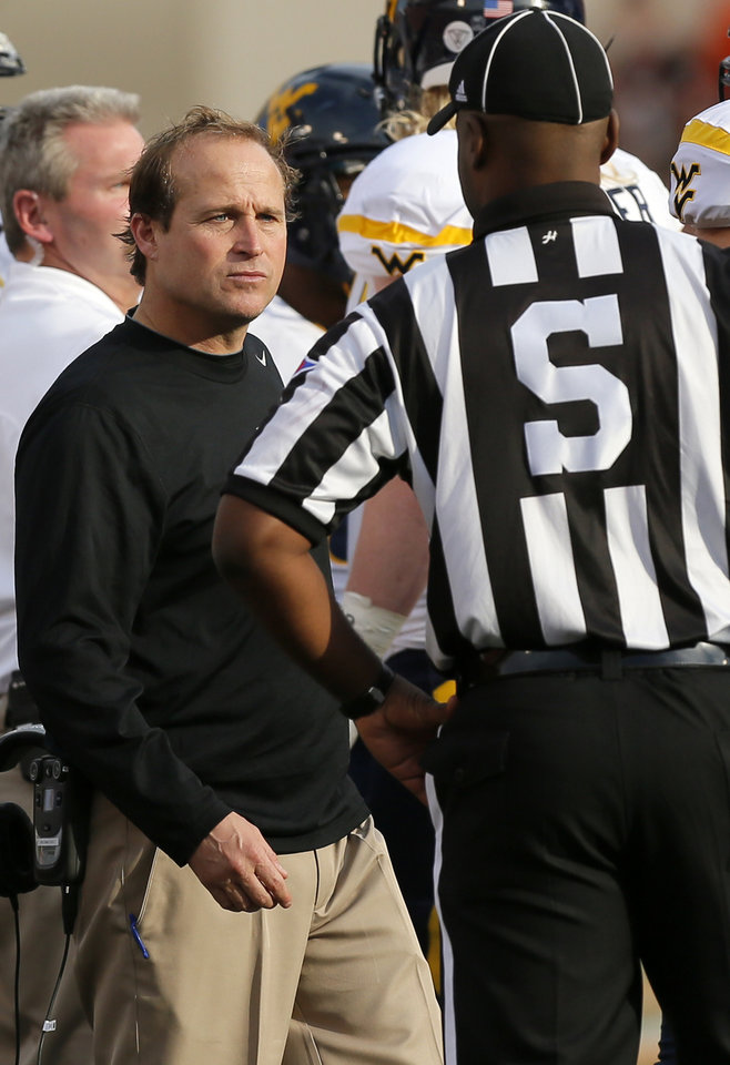 Photo - West Virginia head coach Dana Holgorsen talks to an official during a college football game between Oklahoma State University (OSU) and West Virginia University (WVU) at Boone Pickens Stadium in Stillwater, Okla., Saturday, Nov. 10, 2012. Photo by Nate Billings, The Oklahoman