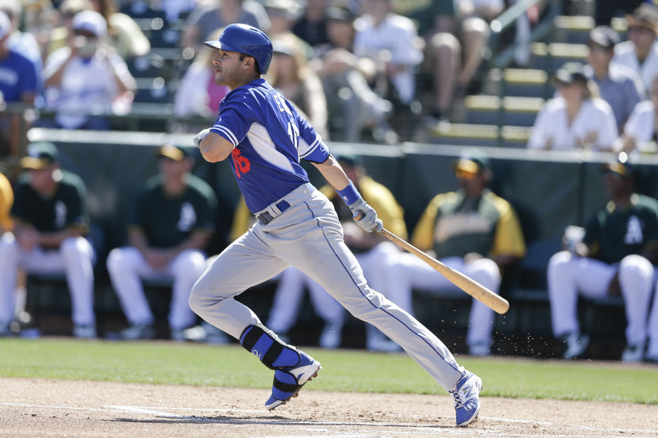 Photo - Los Angeles Dodgers' Andre Ethier watches his hit for a single against the Oakland Athletics during the first inning of a spring training baseball game Monday, March 3, 2014, in Phoenix. (AP Photo/Gregory Bull)