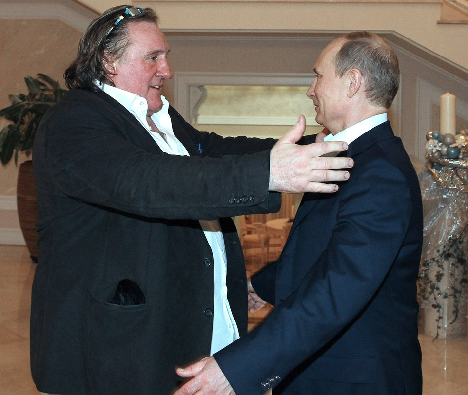 French actor Gerard Depardieu, left, greets Russian President Vladimir Putin after his arrival late Saturday, Jan. 5, 2013, at the president\'s residence in Sochi, the host city of the 2014 Winter Olympics. Depardieu has received a Russian passport after flying to Russia for a late night dinner with Putin. Depardieu sought Russian citizenship as part of his battle against a proposed super tax on millionaires in France, and Putin granted his request last week. (AP Photo/RIA-Novosti, Mikhail Klimentyev, Presidential Press Service)
