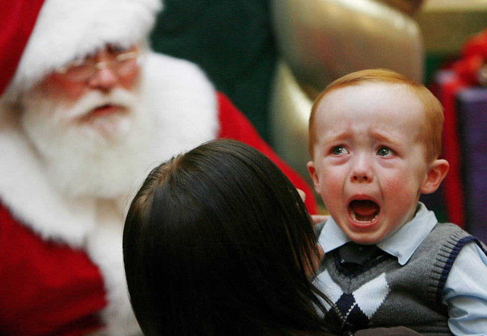 Photo - MALL SANTA CLAUS / CHILD / CHILDREN: Danny Nichols, 2 1/2, Oklahoma City, shows his tears at Penn Square Mall Friday afternoon, Dec. 12, 2008.  This Santa Claus has been playing the