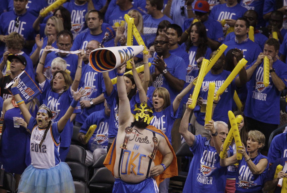 Photo - Oklahoma City Thunder fans cheer the team on against the Miami Heat during the second half at Game 1 of the NBA finals basketball series, Tuesday, June 12, 2012, in Oklahoma City. (AP Photo/Sue Ogrocki)  ORG XMIT: NBA145
