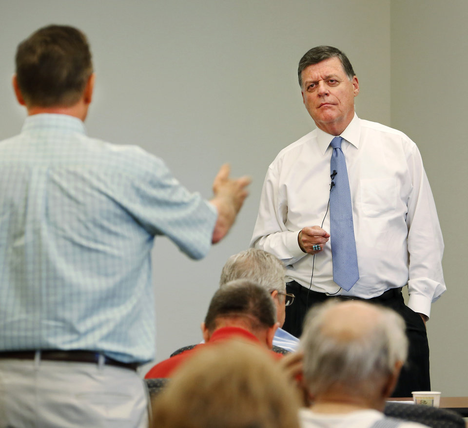 SAVE FOR FILES    U.S. Rep. Tom Cole,  representing Oklahoma's 4th Congressional District, listens to the questions of a constituent during a town hall meeting on Tuesday afternoon, Sep. 3, 2013, in a building at Rose State College.   Photo  by Jim Beckel, The Oklahoman.