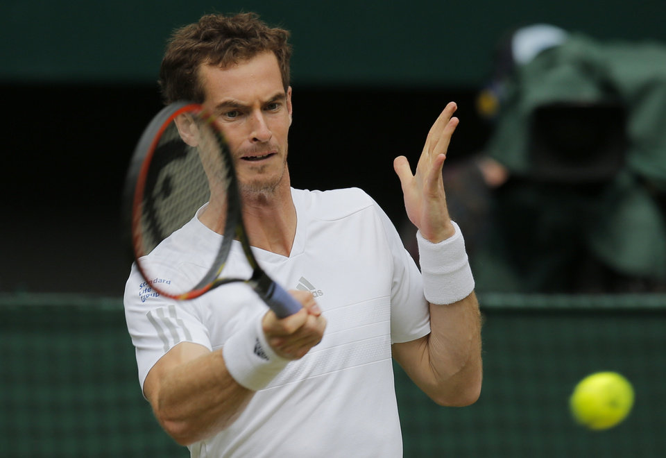 Photo - Andy Murray of Britain plays a return to Kevin Anderson of South Africa during their men's singles match at the All England Lawn Tennis Championships in Wimbledon, London, Monday, June 30, 2014. (AP Photo/Pavel Golovkin)