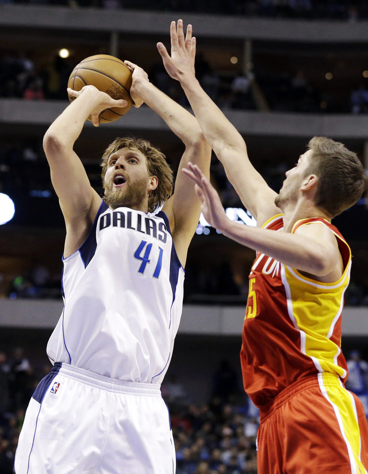 Dallas Mavericks' Dirk Nowitzki (41), of Germany, shoots past Houston Rockets' Chandler Parsons (25) in the second half of an NBA basketball game, Wednesday, March 6, 2013, in Dallas. Nowitzki had 22-points in their 112-108 win. (AP Photo/Tony Gutierrez)