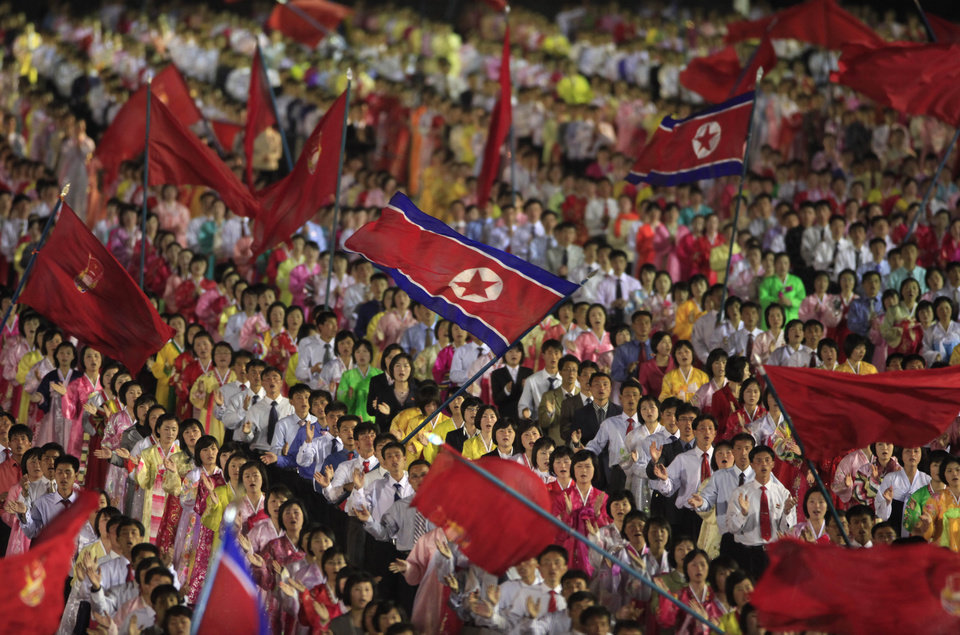 In this Monday, April 16, 2012 photo, students wave the national flags at an evening dancing party and performance at Kim Il Sung Square to commemorate late President Kim Il Sung\'s 100th birthday in Pyongyang, North Korea. (AP Photo/Ng Han Guan)
