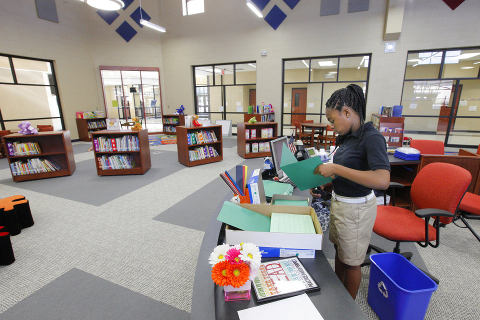 Photo -  Fifth-grader Taniyah Smith, 10, works in the media center at Arbor Grove Elementary. Photo by Paul B. Southerland, The Oklahoman   PAUL B. SOUTHERLAND -