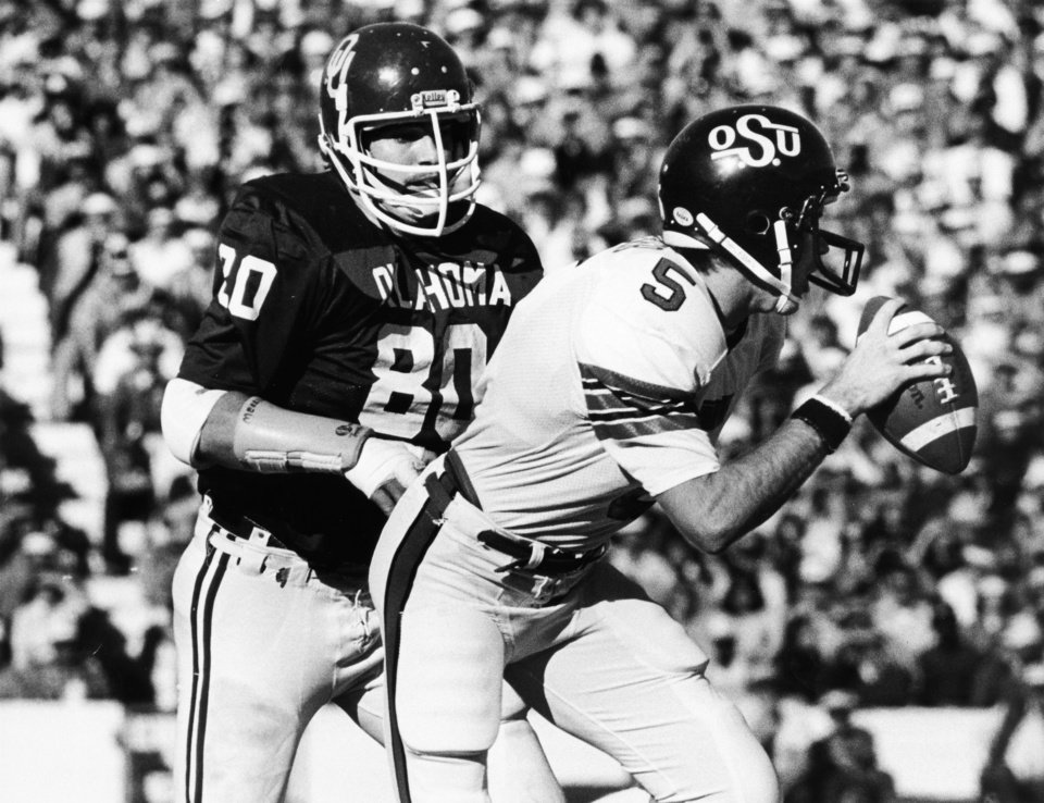 Photo - University of Oklahoma defenseman Rick Bryan (80) closes in on Oklahoma State University quarterback John Doerner (5) during Bedlam college football action in Norman, Okla., on Nov. 29, 1980.  The OU Sooners defeated the  OSU Cowboys, 63-14. Staff photo by Jim Argo