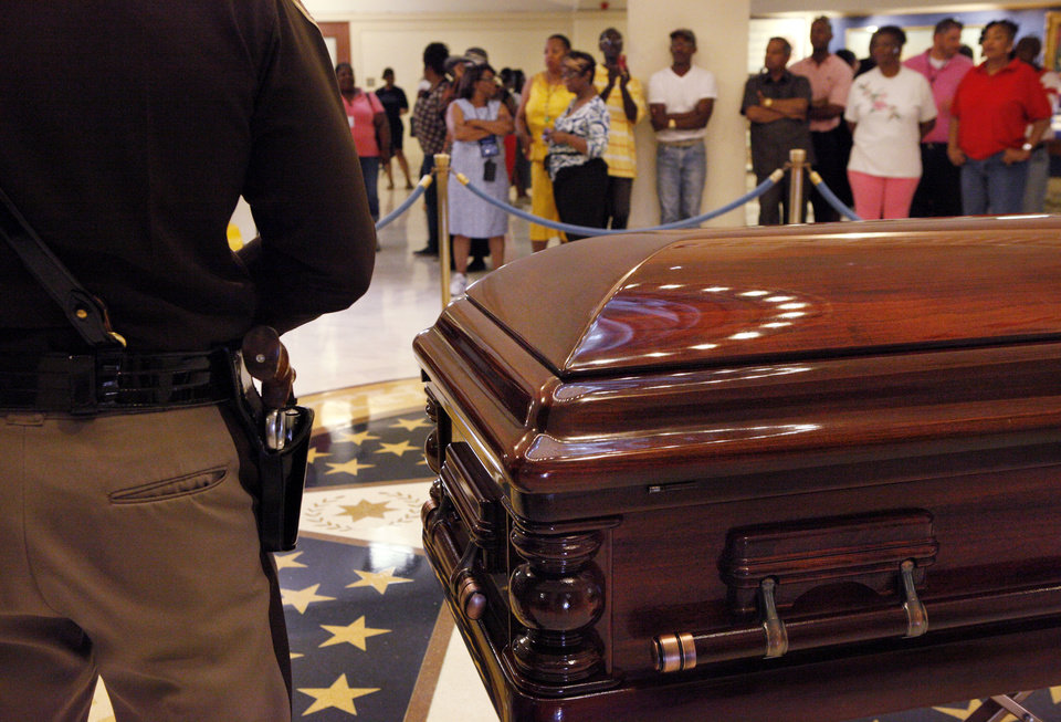 Photo - Oklahoma civil rights leader  Clara Luper was honored by the state as her body lay in repose on the first floor of the State Capitol, Thursday, June 16, 2011. Her dark wood casket remained closed as a pair of Oklahoma Highway Patrol troopers stood silently on either side of the casket. Luper died in Oklahoma City last week. Photo by Jim Beckel, The Oklahoman