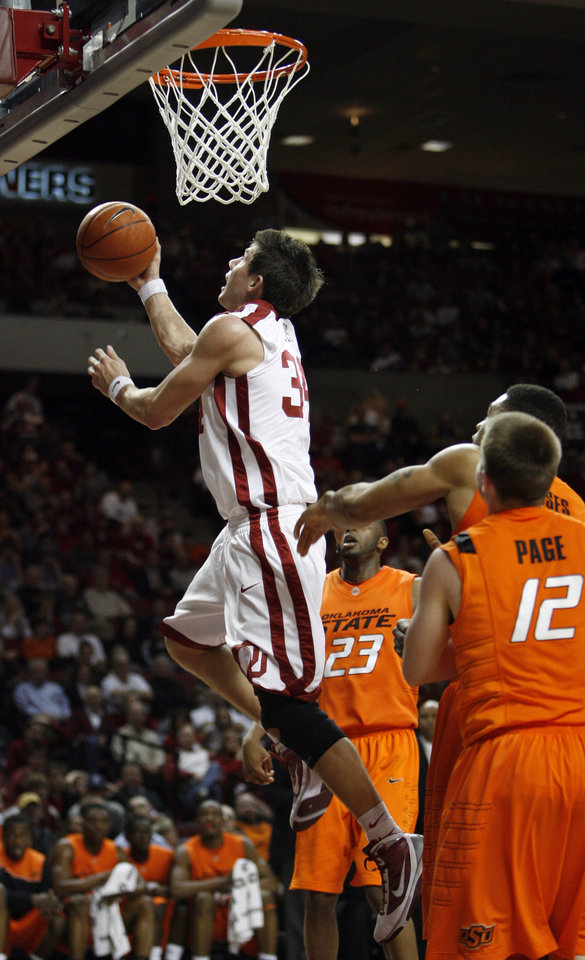 Photo - Cade Davis scores during the first half of the college bedlam basketball game between The University of Oklahoma Sooners (OU) and Oklahoma State University University Cowboys (OSU) at the Lloyd Noble Center on Monday, Jan. 11, 2010, in Norman, Okla.