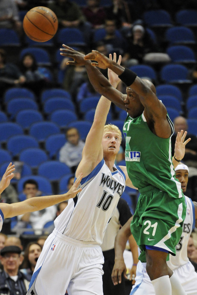 Photo -   Maccabi Haifa's Cory Carr, right, makes a pass as Minnesota Timberwolves' Chase Budinger defends in the first half of an NBA exhibition basketball game against the Israeli team, Tuesday, Oct. 16, 2012, in Minneapolis. (AP Photo/Jim Mone)