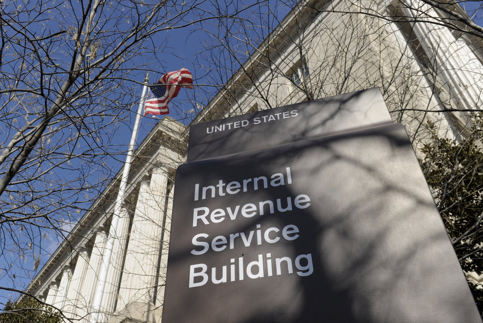 Photo - FILE - This March 22, 2013 file photo shows the exterior of the Internal Revenue Service building in Washington. The Internal Revenue Service long has resisted efforts by an internal watchdog to help groups seeking tax-exempt status, creating a culture that enabled agents to improperly target such organizations for additional scrutiny, the National Taxpayer Advocate reported Wednesday. Nina E. Olson, who runs the independent office within the IRS, said in her annual report to Congress that culture continues today, despite the scandal that has rocked the tax agency for more than a month. (AP Photo/Susan Walsh, File)