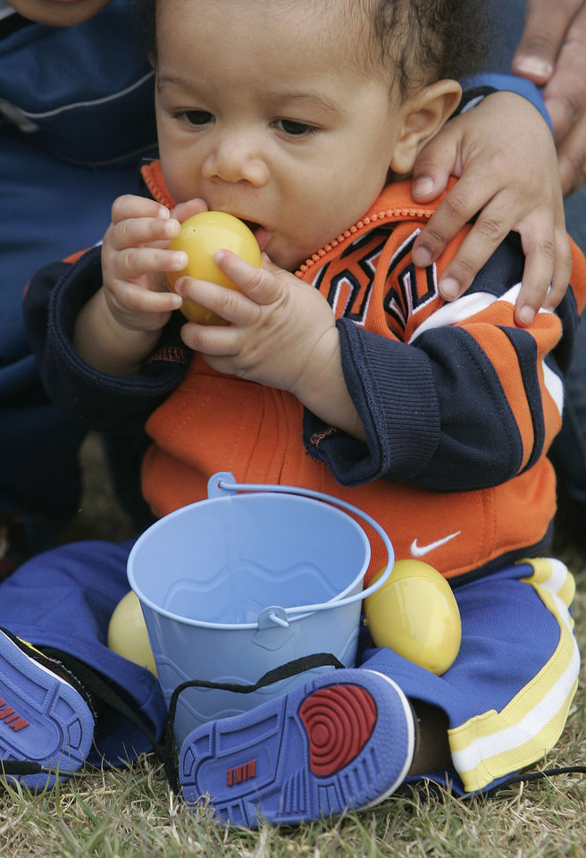 Skyler Carter, 7 months, of Norman, holds an egg he picked up at the Easter egg hunt at Sam Noble Wednesday, April 8, 2009 in Norman. Photo by Jaconna Aguirre, The Oklahoman.