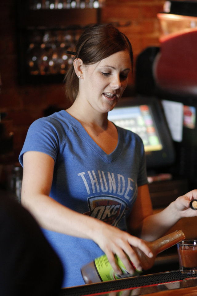 Photo -  Jessie Peeples works behind the bar April 21 at Deep Deuce Grill before Game 2 of the Thunder's playoff series with Memphis. Photo by Doug Hoke, The Oklahoman   DOUG HOKE -