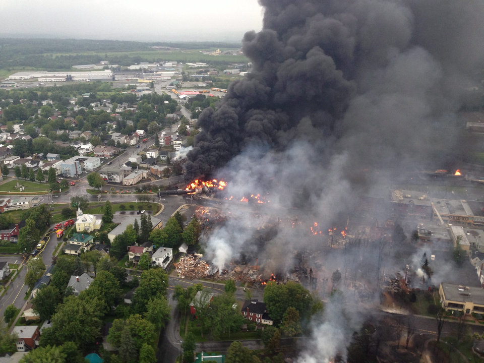 Photo - This aerial photo shows a fire in the town of Lac-Megantic as seen from a Sûreté du Québec helicopter Saturday, July 6, 2013 following a train derailment that sparked several explosions in Lac Megantic, Quebec. (AP Photo/Sûreté du Québec via The Canadian Press)