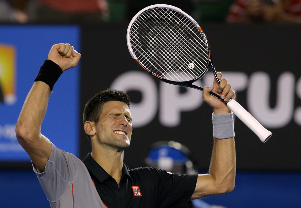 Photo - Novak Djokovic of Serbia celebrates after defeating Lukas Lacko of Slovakia in their first round match at the Australian Open tennis championship in Melbourne, Australia, Monday, Jan. 13, 2014..(AP Photo/Aaron Favila)