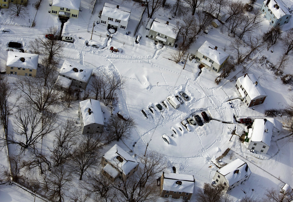 Photo - A Southwest Connecticut neighborhood is buried in snow Sunday, Feb. 10, 2013, in the aftermath of a storm that hit Connecticut and much of the New England states. (AP Photo/Craig Ruttle)
