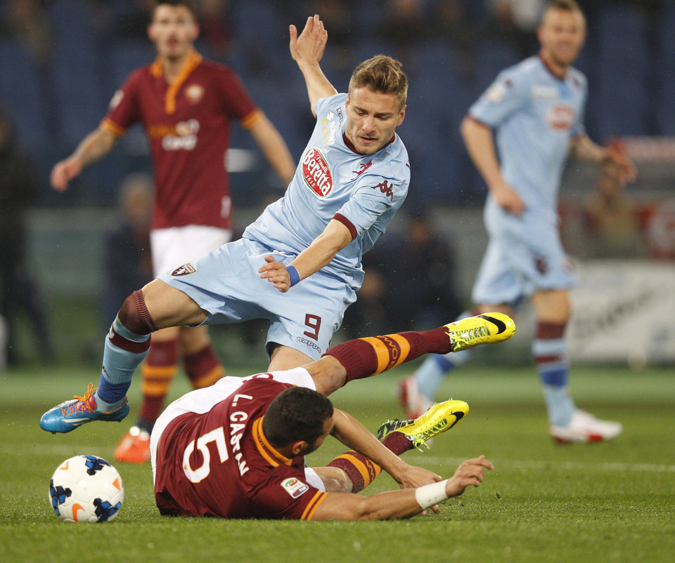 Photo - Torino forward Ciro Immobile, left, and AS Roma defender Leandro Castan of Brazil vie for the ball during a Serie A soccer match between AS Roma and Torino, at Rome's Olympic Stadium, Tuesday, March 25, 2014. (AP Photo/Andrew Medichini)