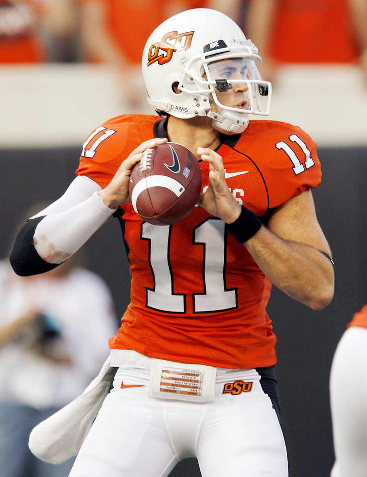 Photo - OSU quarterback Zac Robinson says his receivers are getting better every week. Photo by Nate Billings, The Oklahoman