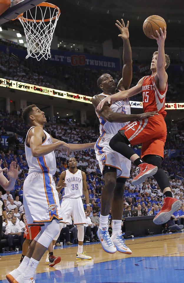 Oklahoma City\'s Thabo Sefolosha (2) and Kendrick Perkins (5) defend on Houston\'s Chandler Parsons (25) during Game 2 in the first round of the NBA playoffs between the Oklahoma City Thunder and the Houston Rockets at Chesapeake Energy Arena in Oklahoma City, Wednesday, April 24, 2013. Photo by Chris Landsberger, The Oklahoman