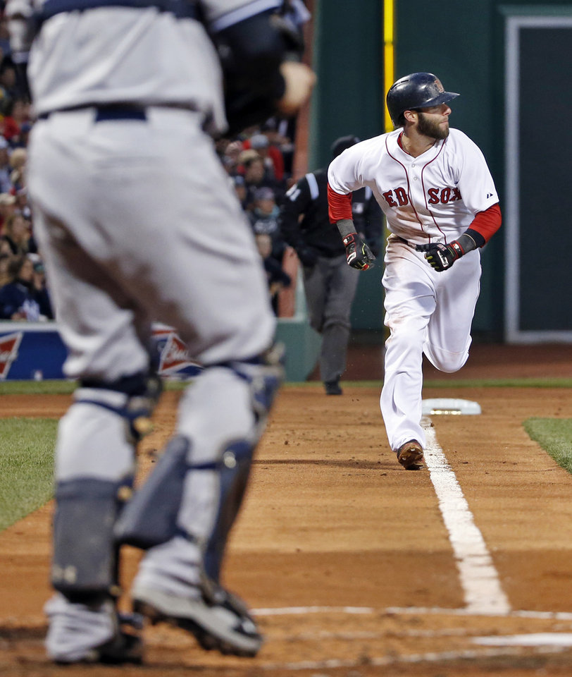 Photo - Boston Red Sox's Dustin Pedroia runs home to score on a single by A.J. Pierzynski in the first inning of a baseball game against the New York Yankees at Fenway Park in Boston, Wednesday, April 23, 2014. (AP Photo/Elise Amendola)