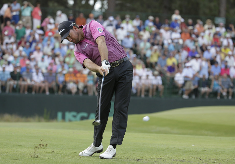 Photo - Graeme McDowell, of Northern Ireland, hits his tee shot on the 13th hole during the first round of the U.S. Open golf tournament in Pinehurst, N.C., Thursday, June 12, 2014. (AP Photo/Charlie Riedel)