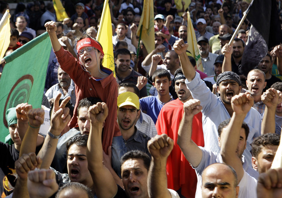 Tens of thousands of people take part a protest in Lebanon's eastern city of Baalbek, Lebanon, Friday, Sept. 21, 2012, for the latest in a series of protest rallies organized by the Shiite militant group Hezbollah. Anger over insults to Islam's Prophet Muhammad isn't enough to bring Lebanon's divided Sunni and Shiite Muslims together. The two sects, which have been locked in sometimes violent political competition, hold separate protests and even throw gibes. A hardline Sunni cleric accuses Shiite Hezbollah of using the protests to distract from the fighting in neighboring Syria. AP photo