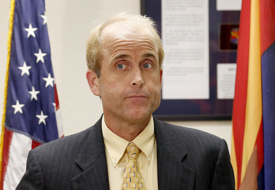 Photo - Doug Nick, the media relations administrator for the Arizona Department of Corrections, pauses as he speaks during a news conference detailing the nearly two hour long execution of Joseph Rudolph Wood at the state prison on Wednesday, July 23, 2014, in Florence, Ariz.  Wood was convicted in the 1989 shooting deaths of Debbie Dietz, 29, and Gene Dietz, 55, at an auto repair shop in Tucson. (AP Photo)