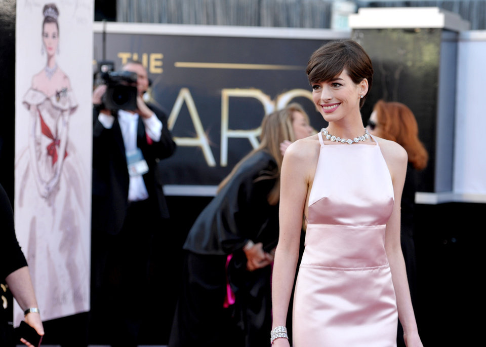Photo - Actress Anne Hathaway arrives at the Oscars at the Dolby Theatre on Sunday Feb. 24, 2013, in Los Angeles. (Photo by John Shearer/Invision/AP)