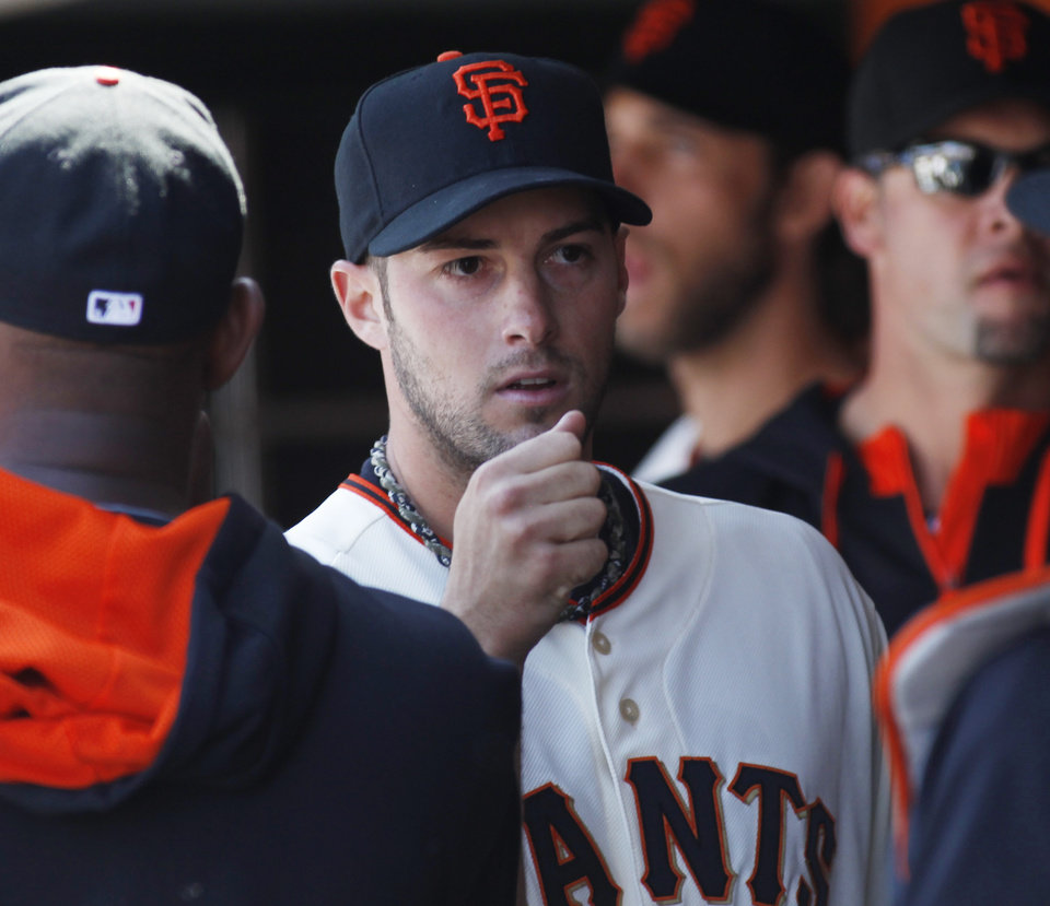 Photo - San Francisco Giants pitcher George Kontos is greeted in the dugout after leaving a baseball game in the seventh inning against the Chicago Cubs, Wednesday, May 28, 2014, in San Francisco. The Giants won 5-0. (AP Photo/George Nikitin)