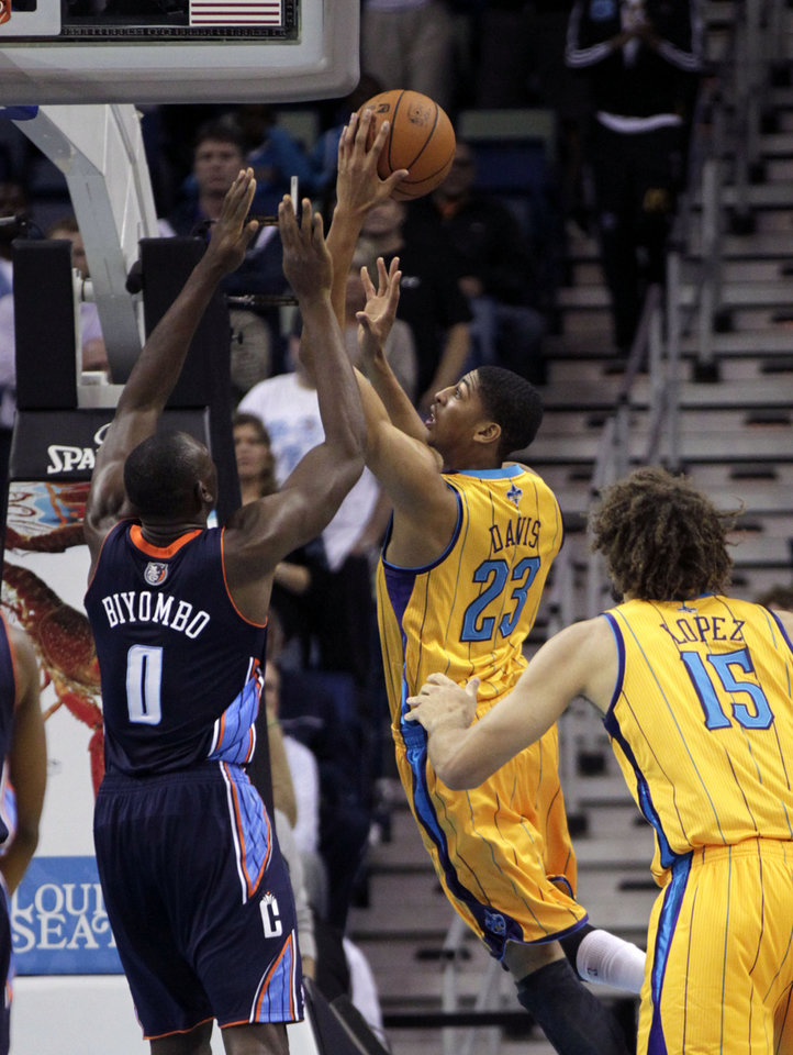 New Orleans Hornets power forward Anthony Davis (23) drives to the basket against Charlotte Bobcats power forward Bismack Biyombo (0) in the first half of an NBA basketball game in New Orleans, Friday, Nov. 9, 2012. (AP Photo/Gerald Herbert)