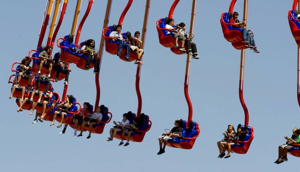 Photo - FILE - This Tuesday, Aug. 23, 2011 file photo shows Windseeker, Knottís Berry Farm newest ride, holding 64 riders in 32 suspended twin seats, in Buena Park, Calif. Once a regional amusement park chain, Cedar Fair Entertainment Co. has become an industry giant. It brought in 23.5 million visitors last year to its amusement and water parks, including Cedar Point and Kings Island in Ohio and Knott's Berry Farm near Los Angeles. (AP Photo/Orange County Register, Mark Rightmire, File)  MAGS OUT; LOS ANGELES TIMES OUT