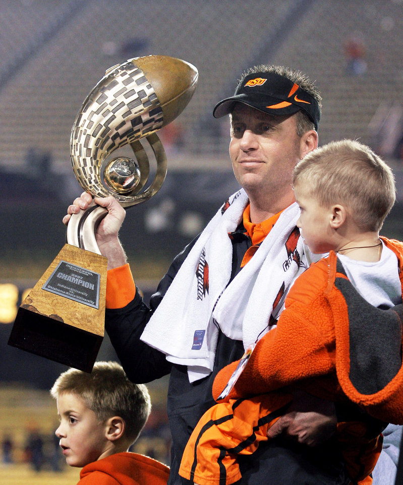Photo - Mike Gundy and the Cowboys won the Insight Bowl last year. AP Photo