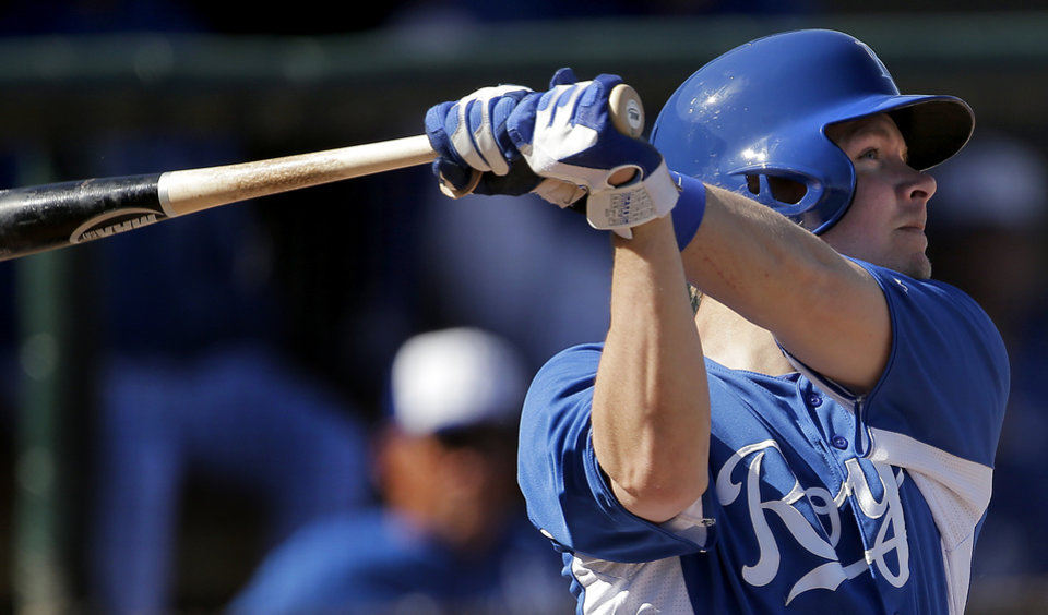 Kansas City Royals' Chris Getz watches his solo home run during the fifth inning of an exhibition spring training baseball game against the Cincinnati Reds, Friday, March 1, 2013, in Surprise, Ariz. (AP Photo/Charlie Riedel)