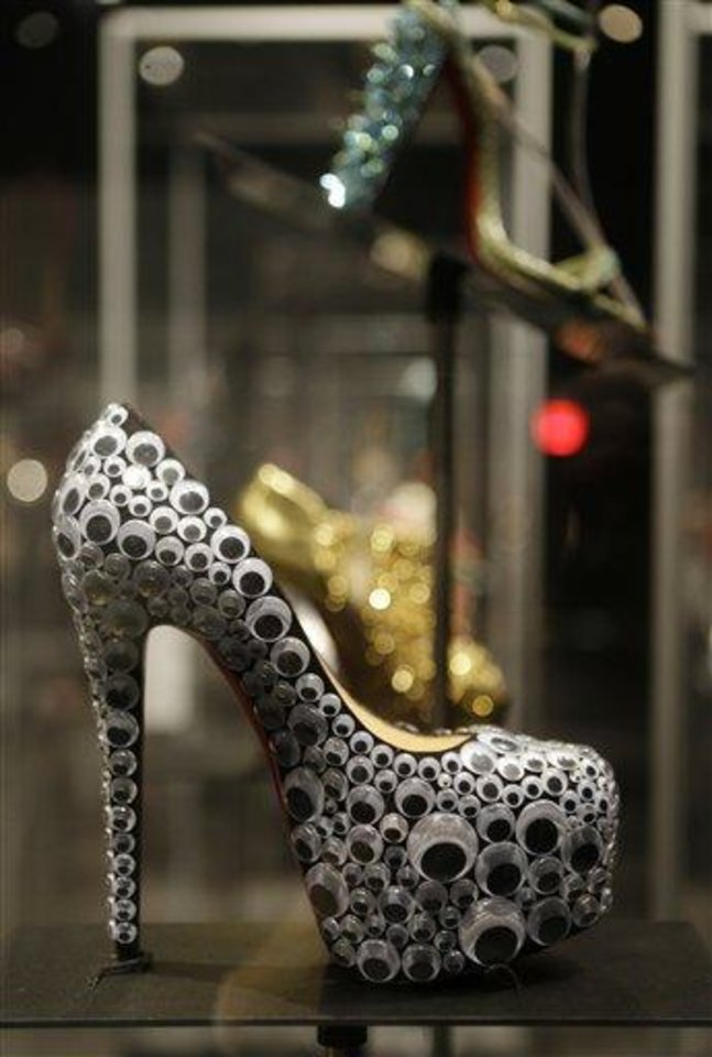"This Feb. 11, 2013 photo shows a Christian Louboutin's shoe with googly-eye decorations, is displayed at the ""Shoe Obsession"" exhibit at The Museum at the Fashion Institute of Technology Museum in New York. The exhibition, showing off 153 specimens, runs through April 13. (AP Photo/Kathy Willens)"
