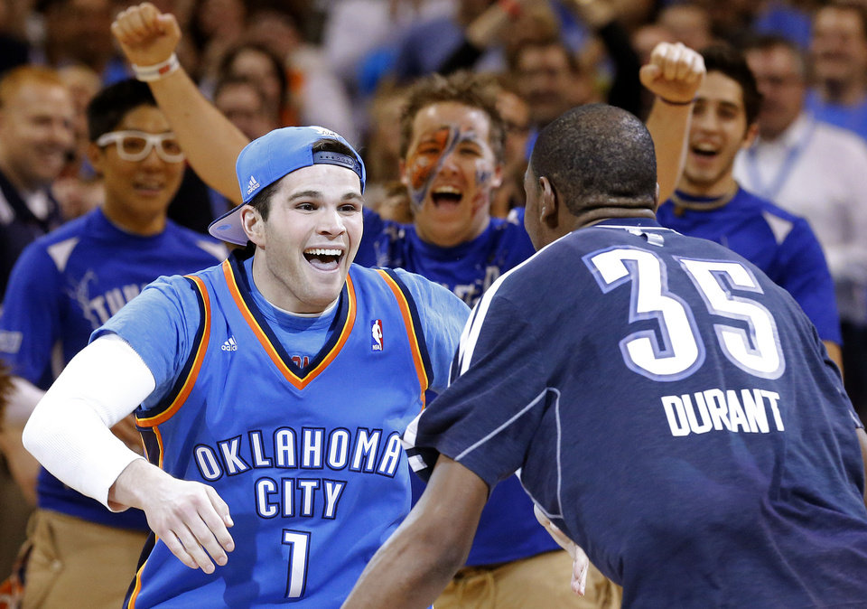 Justin Dougherty is greeted by Oklahoma City's Kevin Durant (35) after he made a 20,000 dollar half-court shot during the NBA basketball game between the Oklahoma City Thunder and the Portland Trail Blazers at the Chesapeake Energy Arena in Oklahoma City, Sunday, March, 24, 2013. (AP Photo/The Oklahoman, Sarah Phipps)