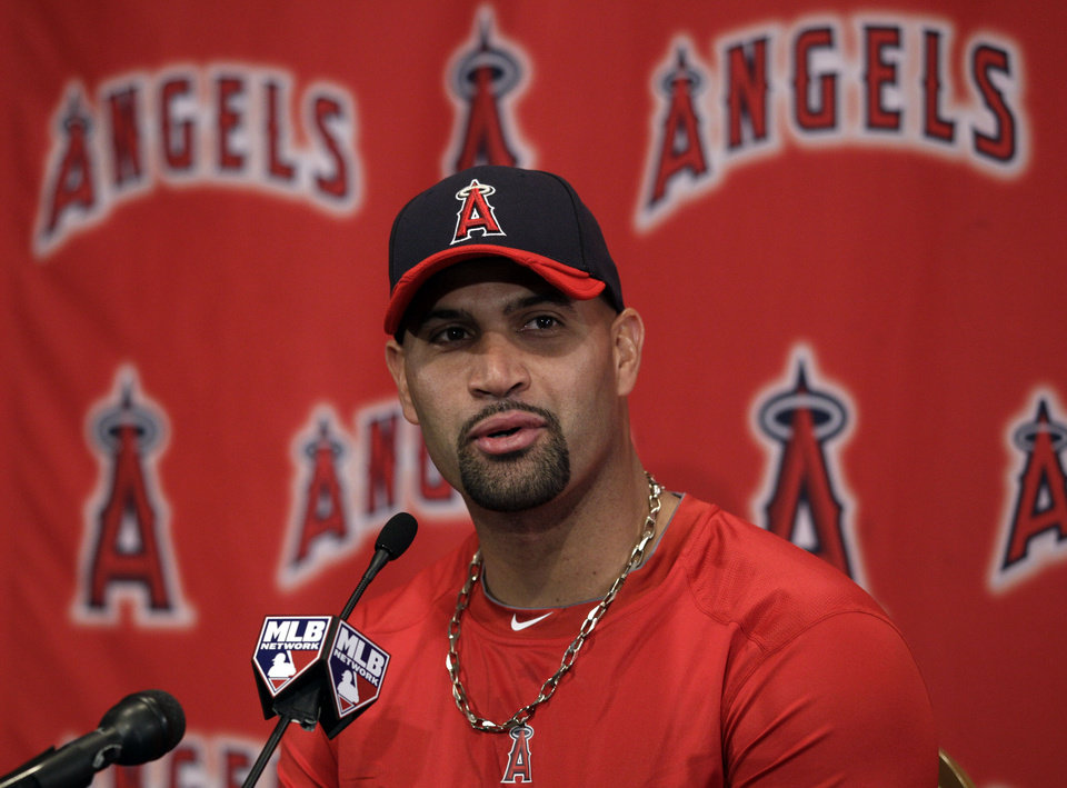 Los Angeles Angels' Albert Pujols answers a question during a news conference after a spring training baseball workout, Monday, Feb. 20, 2012, in Tempe, Ariz. (AP Photo/Morry Gash)