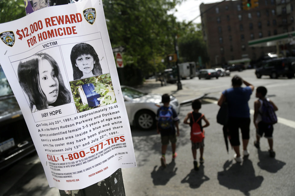 FILE - A Tuesday, July 23, 2013, file photo shows a poster soliciting information regarding an unidentified body near the site where the body was found in New York. In a cold case more than two decades old, investigators used DNA to identify the mother of a dead child known only as Baby Hope, police said Tuesday, Oct. 8, 2013. (AP Photo/Seth Wenig,File)