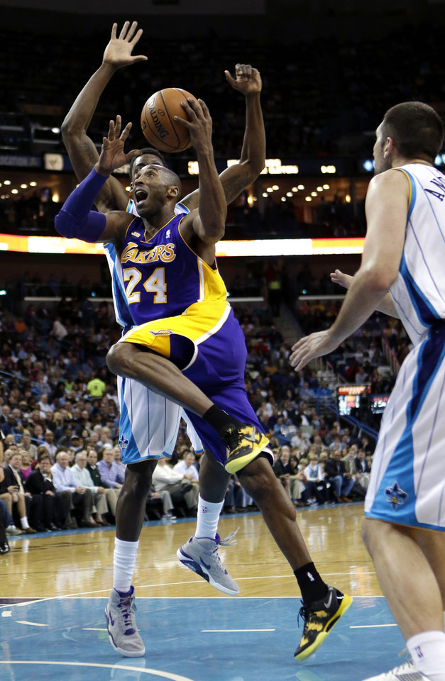 Los Angeles Lakers guard Kobe Bryant (24) drives to the basket past New Orleans Hornets forward Al-Farouq Aminu, behind, during the first half of an NBA basketball game in New Orleans, Wednesday, March 6, 2013. (AP Photo/Gerald Herbert)