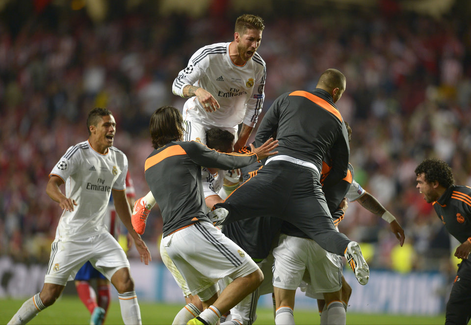 Photo - Real's Sergio Ramos , centre in air, reacts with teammates, at the end of the Champions League final soccer match between Atletico Madrid and Real Madrid, at the Luz stadium, in Lisbon, Portugal, Saturday, May 24, 2014. (AP Photo/Manu Fernandez)