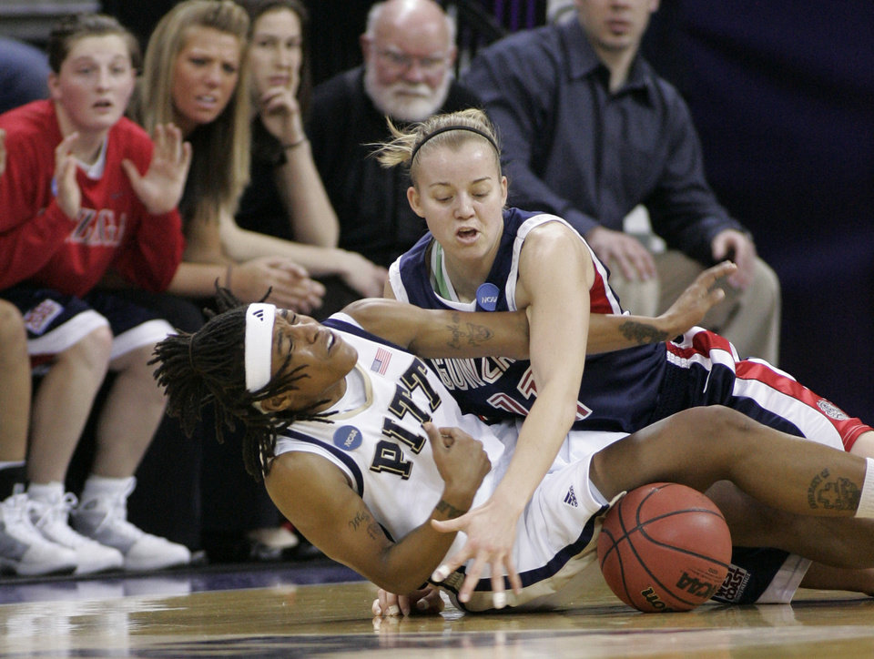 Photo - GONZAGA UNIVERSITY / UNIVERSITY OF PITTSBURGH: Pittsburgh's Shavonte Zellous, left, and Gonzaga's Janelle Bekkering vie for a loose ball during the first half in Seattle on Monday, March 23, 2009, in a second-round women's NCAA college basketball tournament game. (AP Photo/John Froschauer) ORG XMIT: WAJF101