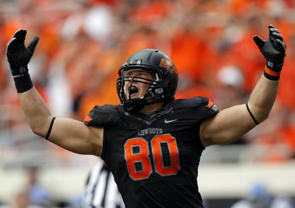 Photo - CELEBRATION: Oklahoma State's Cooper Bassett (80) celebrates a play during the first half of the college football game between the Oklahoma State University Cowboys (OSU) and the University of Kansas Jayhawks (KU) at Boone Pickens Stadium in Stillwater, Okla., Saturday, Oct. 8, 2011. Photo by Sarah Phipps, The Oklahoman    ORG XMIT: KOD