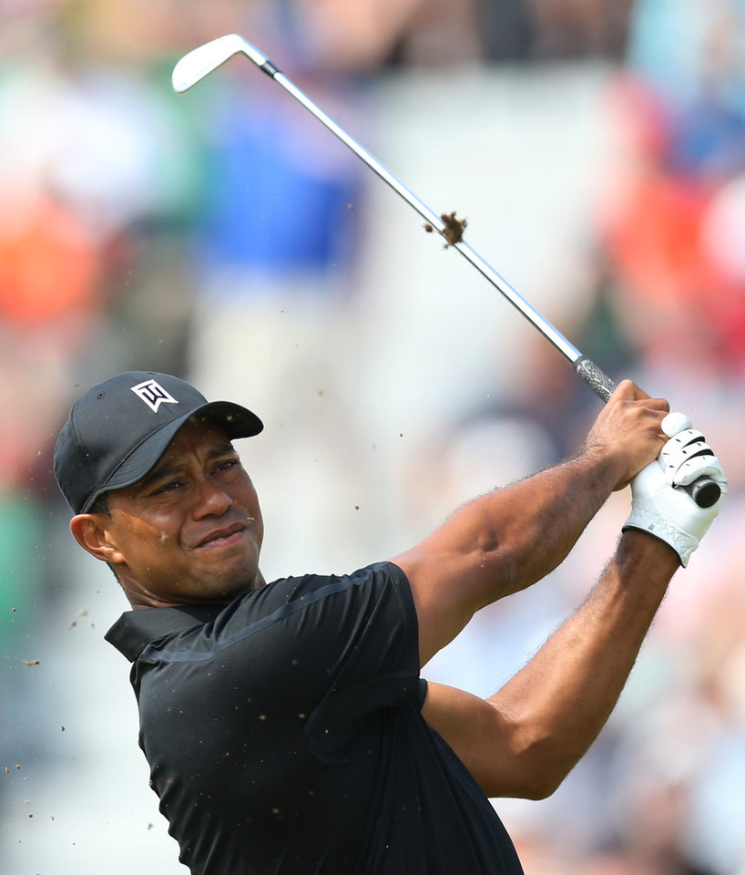 Photo - Tiger Woods of the US plays a shot on the 4th hole during the second day of the British Open Golf championship at the Royal Liverpool golf club, Hoylake, England, Friday July 18, 2014. (AP Photo/Scott Heppell)