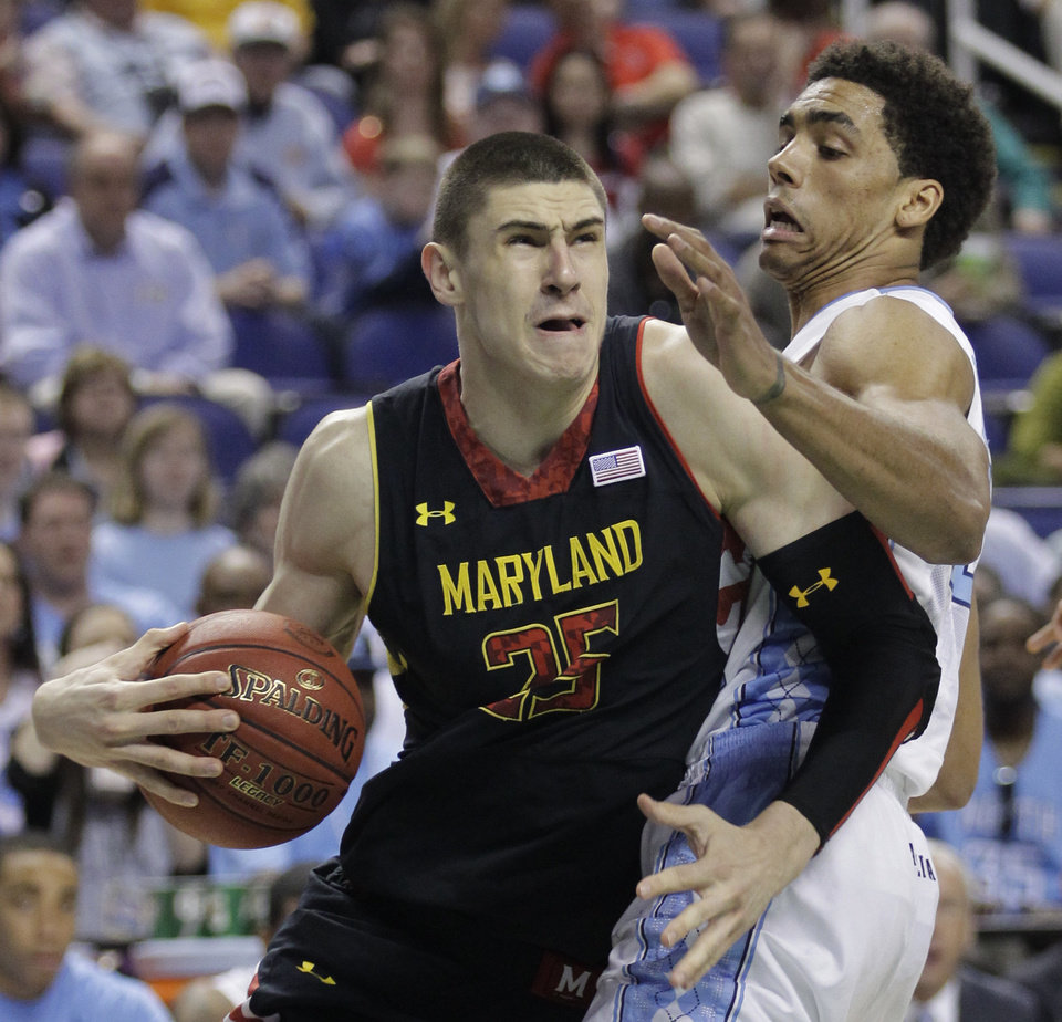 Maryland's Alex Len, left, drives past North Carolina's James Michael McAdoo during the first half of an NCAA college basketball game in the semifinals of the Atlantic Coast Conference tournament in Greensboro, N.C., Saturday, March 16, 2013. (AP Photo/Bob Leverone)