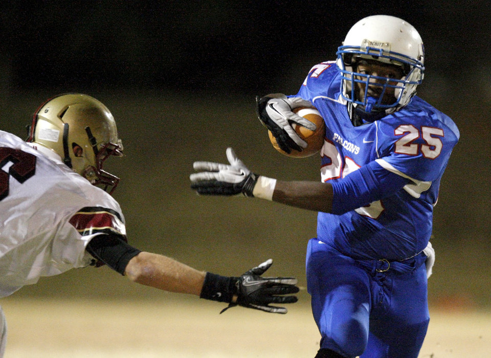Millwood\'s Sheldon Bulock runs past Lincoln Christian\'s Andrew Wright during a Class 2A high school football playoff game between Millwood and Lincoln Christian in Oklahoma City, Friday, Nov. 25, 2011. Photo by Bryan Terry, The Oklahoman