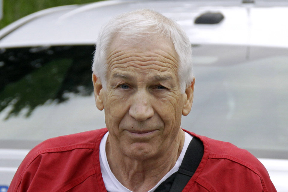 Photo -   Former Penn State University assistant football coach Jerry Sandusky arrives for sentencing at the Centre County Courthouse in Bellefonte, Pa., Tuesday, Oct. 9, 2012. (AP Photo/Gene J. Puskar)
